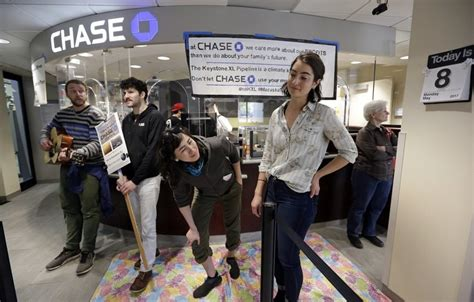 Climate activists shut down Chase bank branches in Seattle