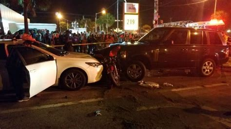 3 injured after motorcycle gets pinned between vehicles